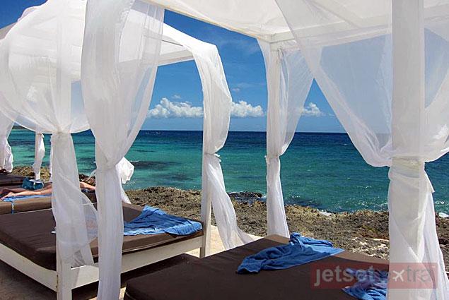 A view of the ocean through the cabanas
