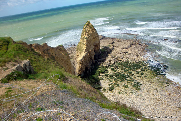 The cliff at Pointe du Hoc rose some 100 feet from the beach