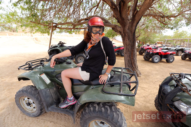 Mary Anne sporting the latest in ATV chic on her beach ride with Carisuva
