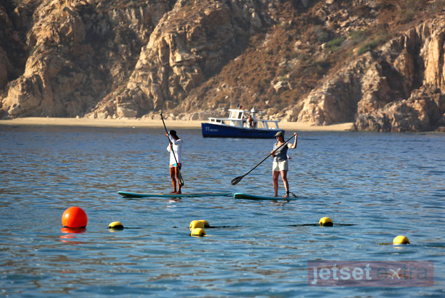 Mary Anne and Lizzy as they stand-up paddle board