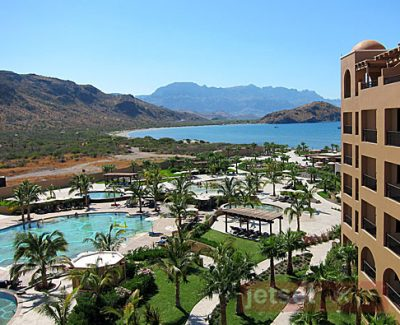 All guestrooms at Villa del Palmar Loreto come with balconies that overlook the pools and, beyond that, the Sea of Cortez