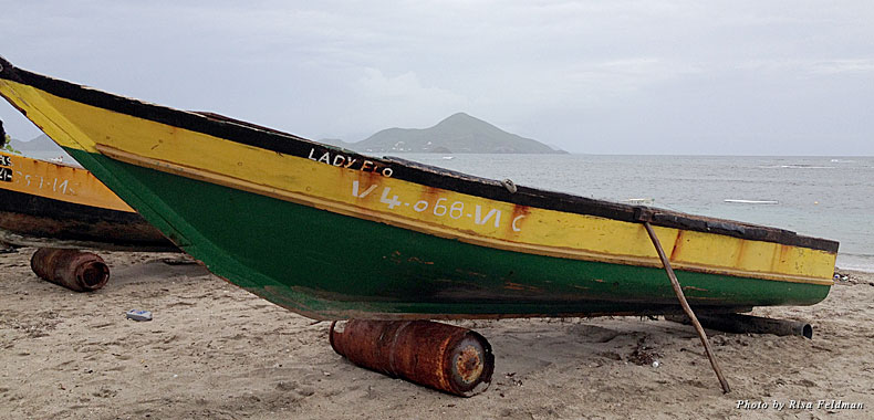 A boat rests on the beach in scenic Nevis