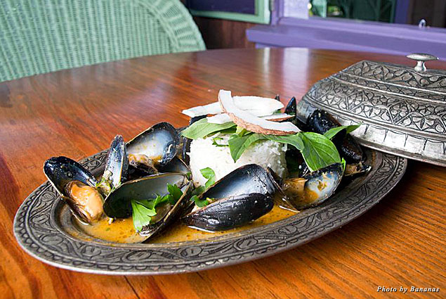 Mussels in a Thai red curry served with shaved coconut and fresh basil