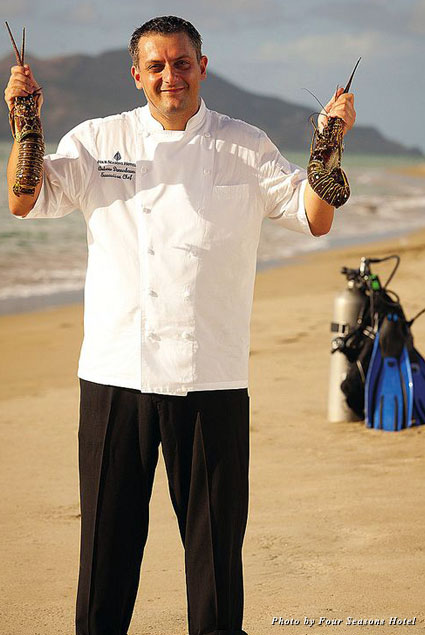 Executive chef Andreas Donnerbauer with his lobster catch at Four Seasons Resort Nevis