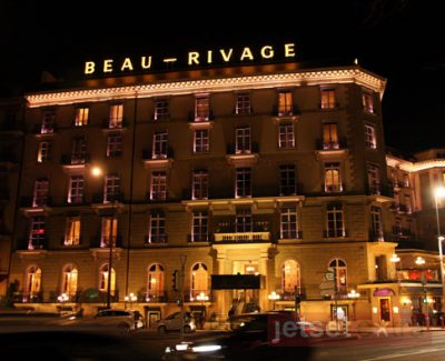 Nighttime view of the Beau-Rivage Hotel in Geneva, Switzerland