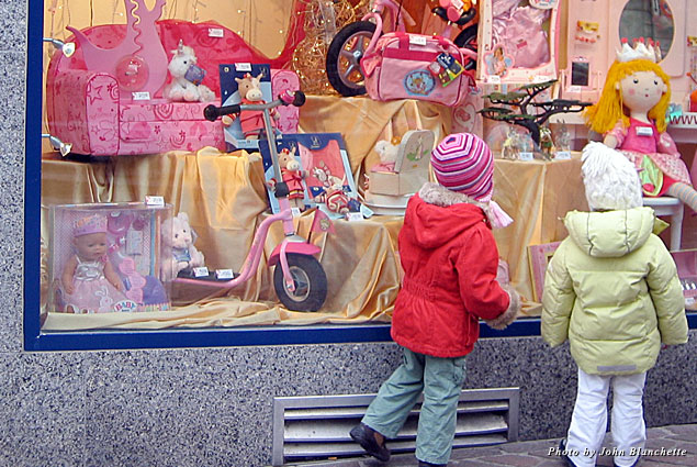 Curious shoppers dressed in the colors of the toys examine the season's possibilities