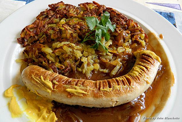 Sausage in onion gravy with rosti at Restaurant Walliserkanne
