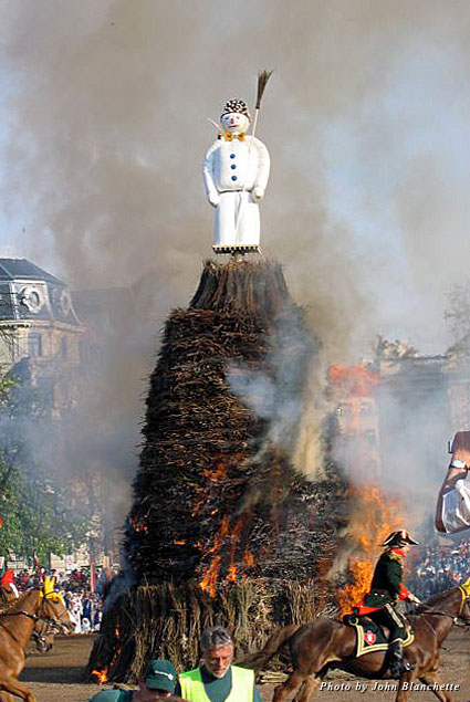 "A snowman, called ""The Böögg,"" is placed atop a 30-foot wooden pyre and lit on fire"