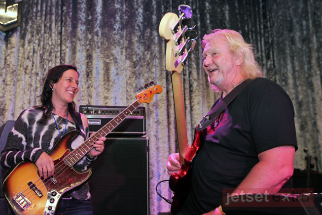 Tracy Boomer playing bass guitar with Chris Squire, the bass player from YES