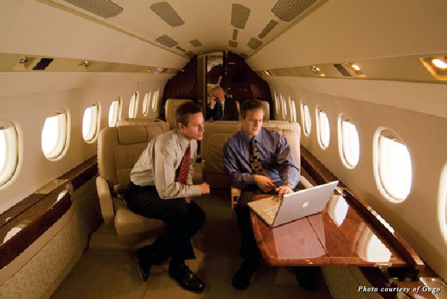 Businessmen use Gogo Inflight Internet