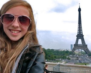 My daughter with the Eiffel Tower in the distance