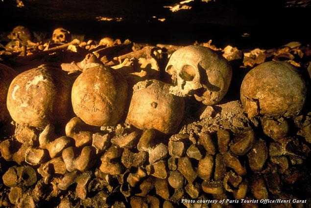 Walls of bones line the Paris Catacombs