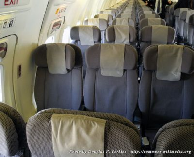 Empty seats on an a 6-seat-wide Qantas jet