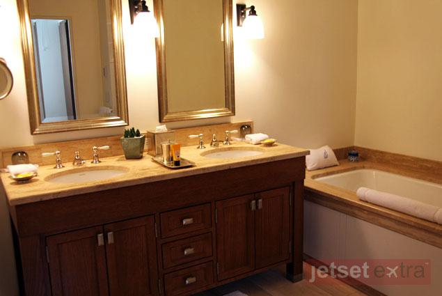 The spacious bathroom features a relaxing bathtub