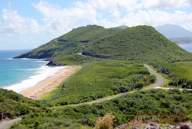 Lush vegetation covers the hills of St. Kitts