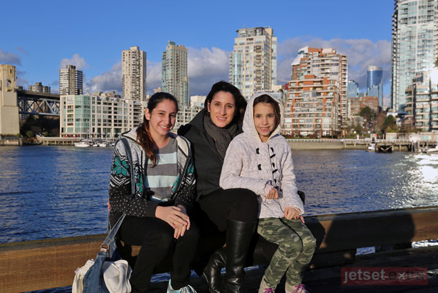 Mary Anne and kids on the waterfront with Vancouver in the background