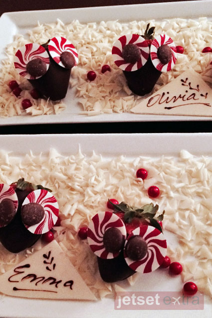 Chocolate-covered strawberries with girls' names on each plate