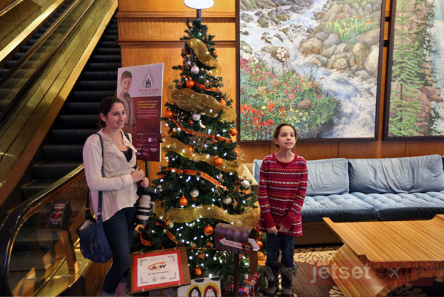 The girls in front of the A&W Company tree