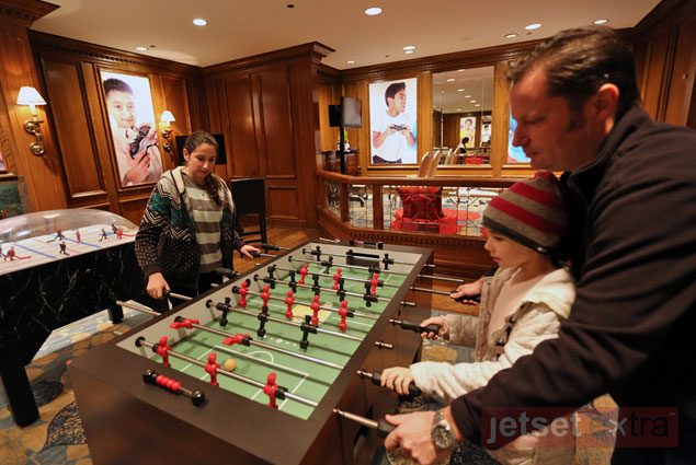 The kids playing foosball with Jason