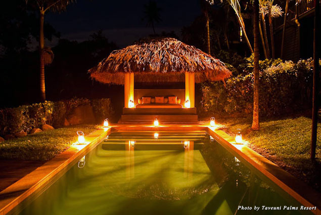 Candles lit around the pool inspire romance