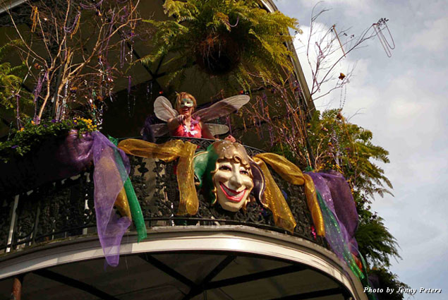 The whole town of New Orleans is decorated in purple, green, and gold during Mardi Gras