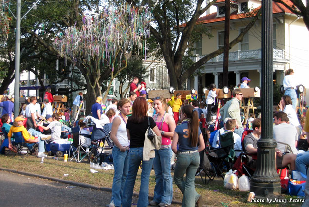 """Families fill the """"neutral ground"""" during every day and night that Mardi Gras parades roll by"""