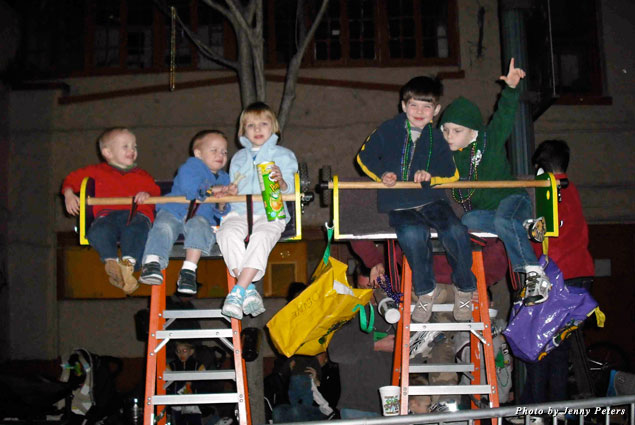 Along the parade route, Mardi Gras is all about the kids