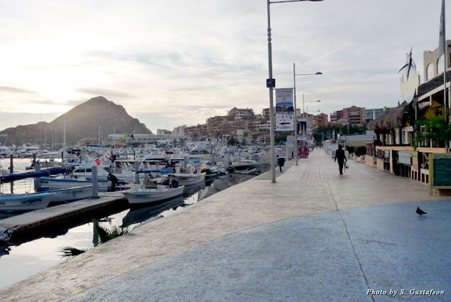 The normally jammed walkway along the marina is empty and is yours to enjoy as the early morning sun begins to peek over Mount Solmar
