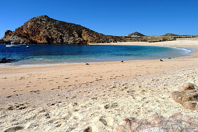 The welcoming sandy bay at Playa Santa Maria beckons you to wade into its shallow and gentle waters