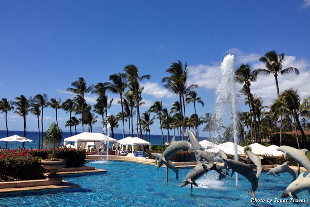 A view of palm trees and dolphin fountain from the Grand Wailea in Wailea, Maui, Hawaii