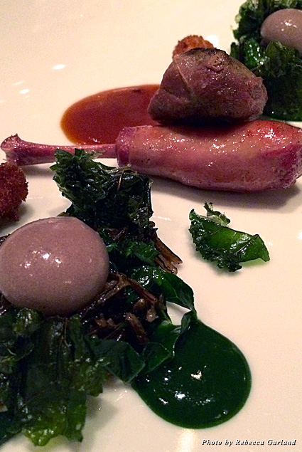 Squab with wild rice, kale, and a red onion sphere and squab jus