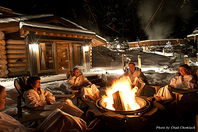 Sitting around the outdoor fireplace at Scandinave Spa
