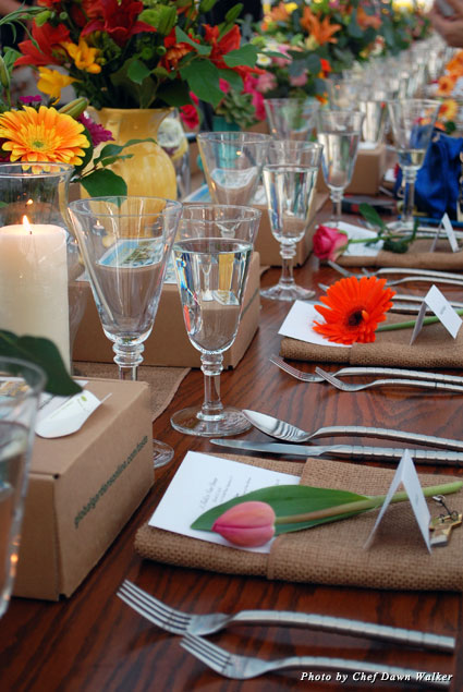 Flowers adorn the table during dinner insider a greenhouse