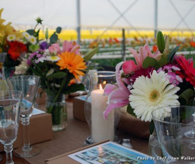 The table is set for dinner insider a gerbera daisy greenhouse
