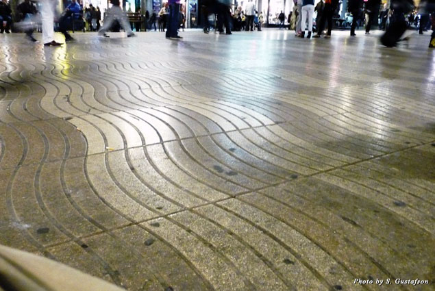 The wavy, almost watery, textured lines in the pavement evoke images of what the road used to be—a waterway from the city walls to the Mediterranean Sea