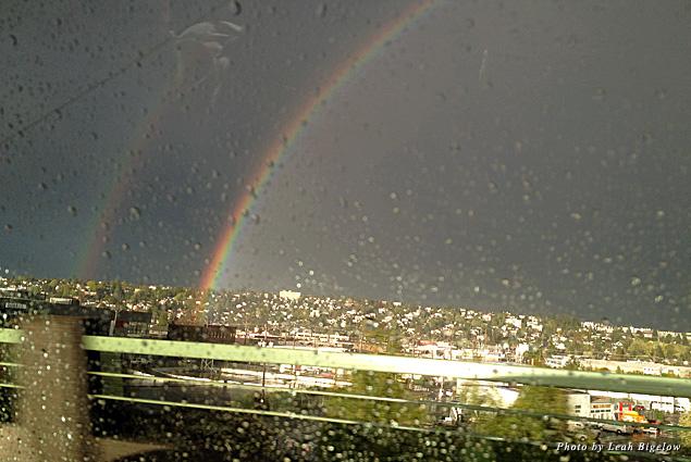 A double rainbow captured through a rainy car window