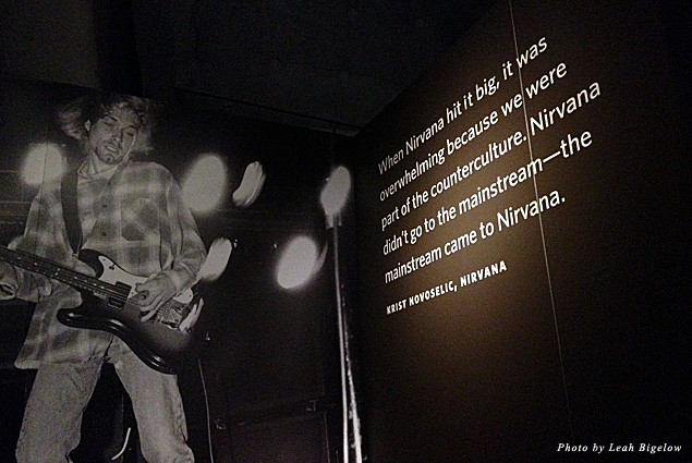 A photo display and quote from Krist Novoselic of Nirvana, part of the EMP Museum's exhibit about the '90s band