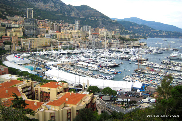 A view of Monaco harbor filled with boats and luxury yachts