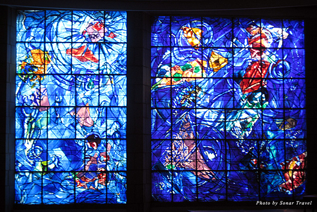 A bright blue stained glass window by Marc Chagall
