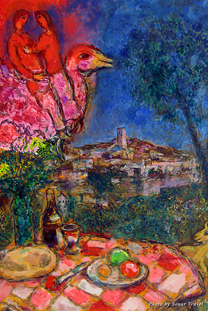 A painting by Marc Chagall featuring a picnic and a couple riding a bird