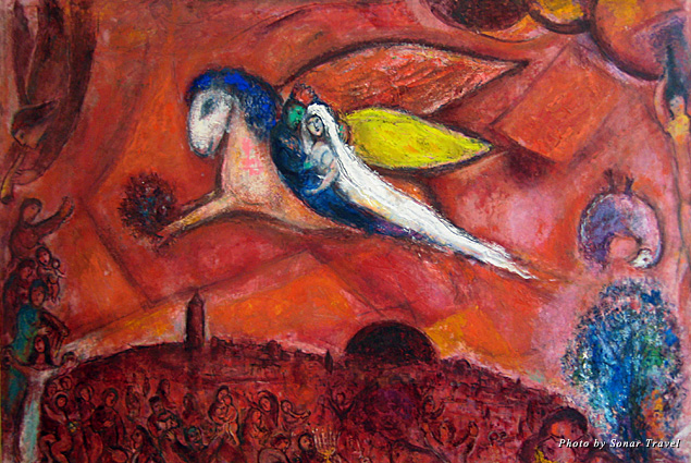 A painting by Marc Chagall of a newlywed couple riding off on winged horse