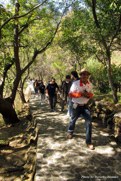 The trail to the Hill of the Idols is a wide cobblestone path, shady most of the way