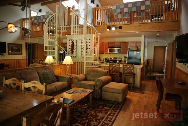 A two-story home at Junipine Resort includes two bedrooms, a living room, and a kitchen