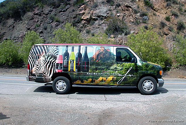 A van shuttles guests from Saddlerock Ranch parking lot to Malibu Wines tasting room on Mulholland Highway