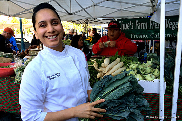 Chef Cynthia selects ingredients at the farmers' market