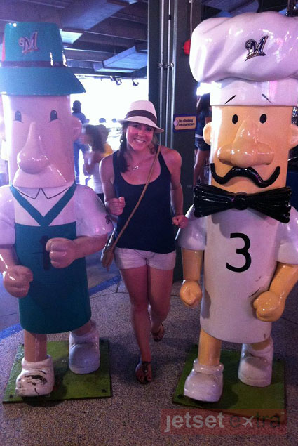 Running with two of the Milwaukee Brewers' sausage mascots