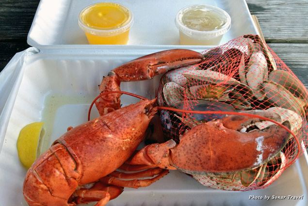 A fresh lobster lunch along with steamed clams and butter