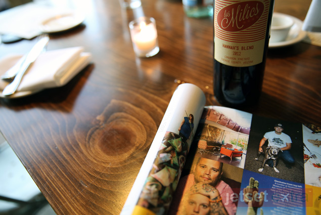 A magazine page highlights FnB co-owner Pavle Milic's wine, which he named after his daughter