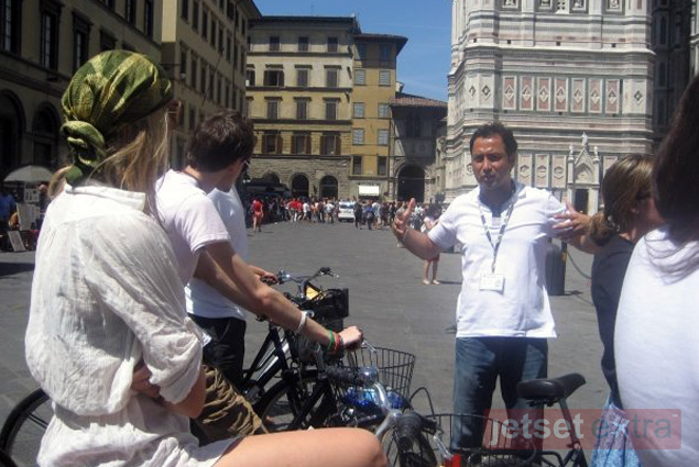 Our I Bike Florence guide shares information about the city during a stop on our bike tour