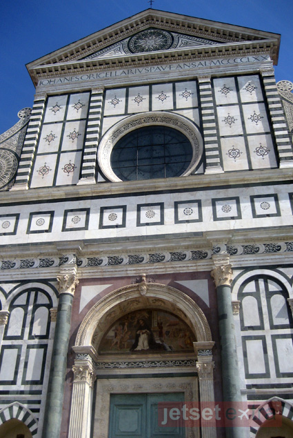 The Basilica of Santa Maria Novella's exterior is a black and white marble façade
